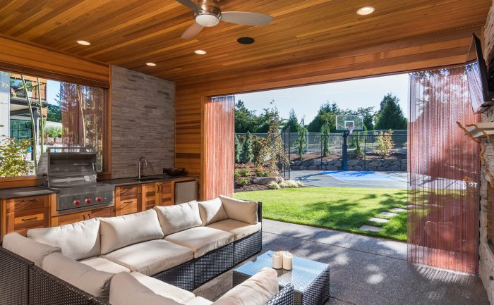 Backyard patio open to a basketball court