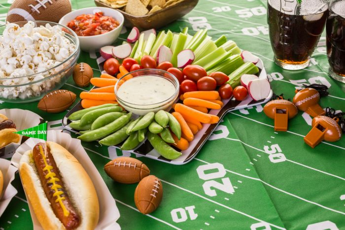 Football snacks including hotdogs, popcorn, and some dips