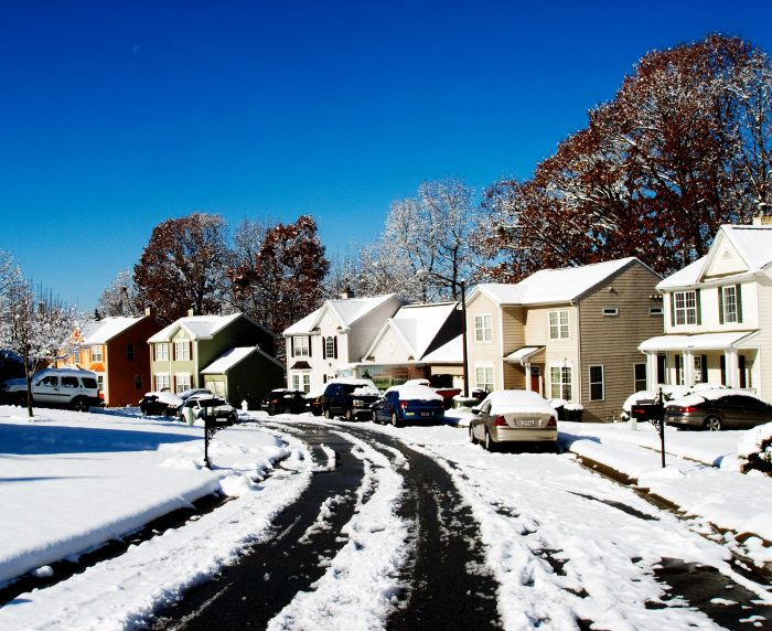 A row of houses in the snow